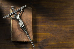 Silver Crucifix and Holy Bible on Wooden Background Stock Photography