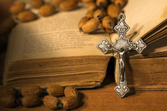 Silver Crucifix Rosary Bead and Holy Bible Stock Images