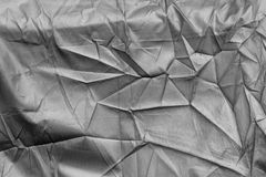 Silver crumpled canvas texture. Background Royalty Free Stock Image
