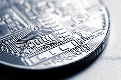 Cryptocurrency coin close-up. Silver cryptocurrency coin, macro shot stock images