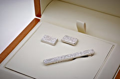Silver cuff link and tie pin. In opened box Stock Photography