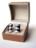 Silver cuff links. In a box on white Royalty Free Stock Photo