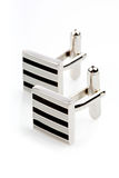 Silver cuff links on white background Royalty Free Stock Images