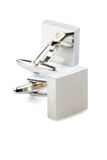 Silver cuff links on white background Stock Photography