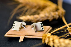 Silver cufflinks royalty free stock photography