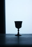 Silver cup. On a table, blue mood. Still life Stock Photo
