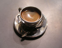 Silver cup of coffee. Smooth and tasty Royalty Free Stock Images