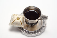Silver cup of coffee with cake. Is on the white background Stock Image