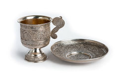 Silver cup and saucer Royalty Free Stock Photos