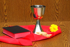 Silver cup, with silver plate and bread Royalty Free Stock Photo