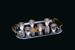 Table laying items. Silver cups for a drink on serving tray for six persons Stock Photo