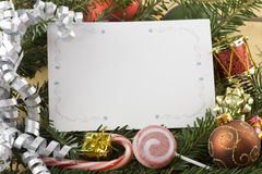 Silver curcly ribbon with blank Christmas card Stock Photo