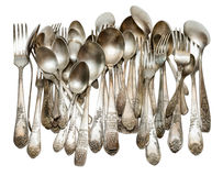 Silver cutlery. Aged vintage silver cutlery (forks, spoons) isolated on white background Stock Photos