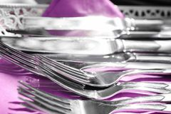 Silver cutlery on lilac napkin. Closeup Royalty Free Stock Images