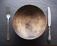 Silver cutlery and old wooden plate. Stock Image