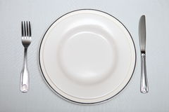 Silver cutlery, plate on the table Royalty Free Stock Images