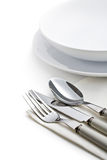 Silver cutlery and plates Royalty Free Stock Images