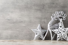 Silver deer on gray background. Christmas background. Stock Image