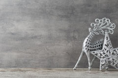 Silver deer on gray background. Christmas background. Stock Images