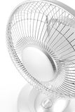 Silver desk fan. Downward view of a silver desk fan on a white background royalty free stock images