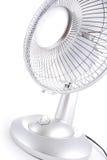 Silver desk fan. Sideward view of a silver desk fan on a white background royalty free stock image