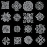 Silver detailed ornament collection. Isolated over black background Stock Photography