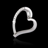 Silver diamond pendant in shape of heart Stock Photography