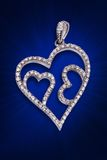 A silver diamond pendent. In heart shaped Royalty Free Stock Photos