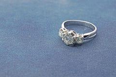 Silver Diamond Ring on Blue Velvet Royalty Free Stock Images