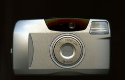 Silver digital camera. A silver digital camera isolated on black Royalty Free Stock Images