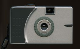 Silver digital camera. A silver digital camera on black Royalty Free Stock Photo