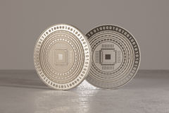 Silver digital crypto-currency coins standing on metal floor as example for virtual currency and fin-tech.  Stock Photography