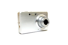 Silver digital photo camera. On white royalty free stock images