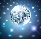 Silver disco bal. L on glowing background Stock Images