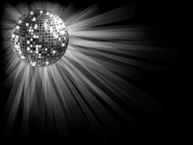 Silver disco ball . Disco ball silver on a black background with rays of light Royalty Free Stock Photography