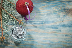 Silver disco bauble red Christmas ball fir brunch on wooden boar. D holidays concept Royalty Free Stock Photo