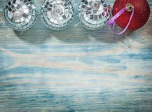 Silver disco baubles red Christmas ball on wooden board holidays Stock Photo