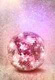 Silver disco mirror ball vintage colors. Disco mirror ball on decayed vintage color background stock images