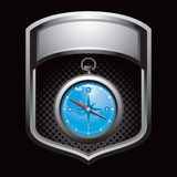 Silver display with blue compass Stock Photography