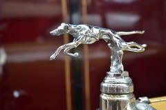 Silver dog logo on a car in Beaulieu Motor Museum. Silver dog logo on a car in The National Motor Museum Beaulieu Royalty Free Stock Image