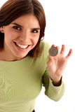 Silver dollar. Portrait of a young pretty woman holding silver dollar royalty free stock photos