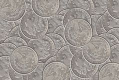 Silver dollar coins background royalty free stock photos
