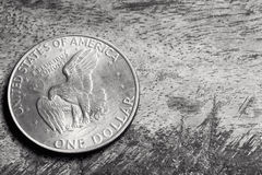 Silver Dollar on Grunge Background. Old silver American dollar coin, over grunge background Royalty Free Stock Image
