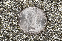 Silver Dollar with Sparkling Glitter Stock Photo