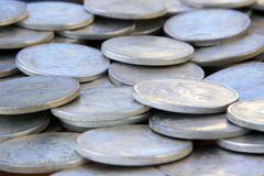 Silver Dollars. Old silver dollars spread out in a pile Stock Photography