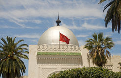 Silver dome mosque Sousse Tunisia Africa. Landmark large silver dome mosque Sousse Tunisia Africa with national flag flying Royalty Free Stock Photos