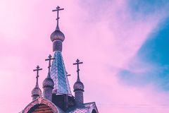 Silver domes of the church against the sky with clouds Royalty Free Stock Image