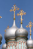 Silver domes of orthodox church. Silver domes of orthodox christian church with golden crosses against clear blue sky Royalty Free Stock Photo