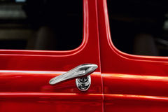 Silver door handles vintage red car Royalty Free Stock Image