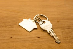 Silver door key placed on wood desk. Keys from doors placed on the wood desk stock photos